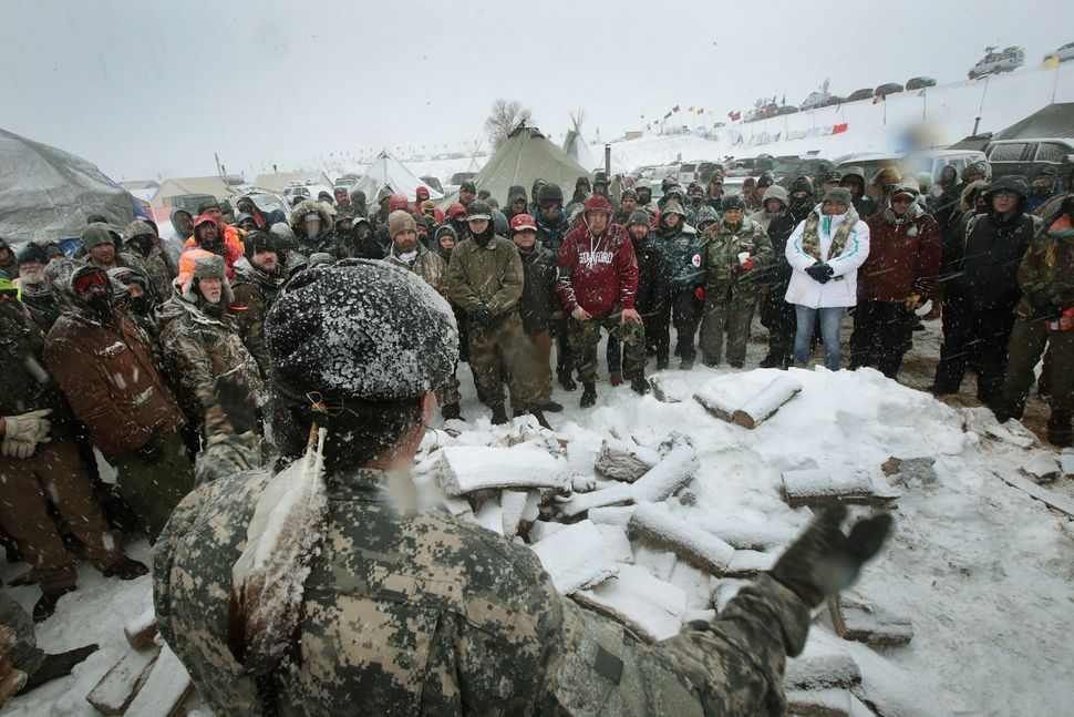 Military veterans are briefed on cold-weather safety issues.
