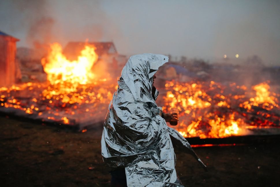 Campers set structures on fire in preparation of an Army Corp's deadline to leave the Oceti Sakowin protest camp on Feb.
