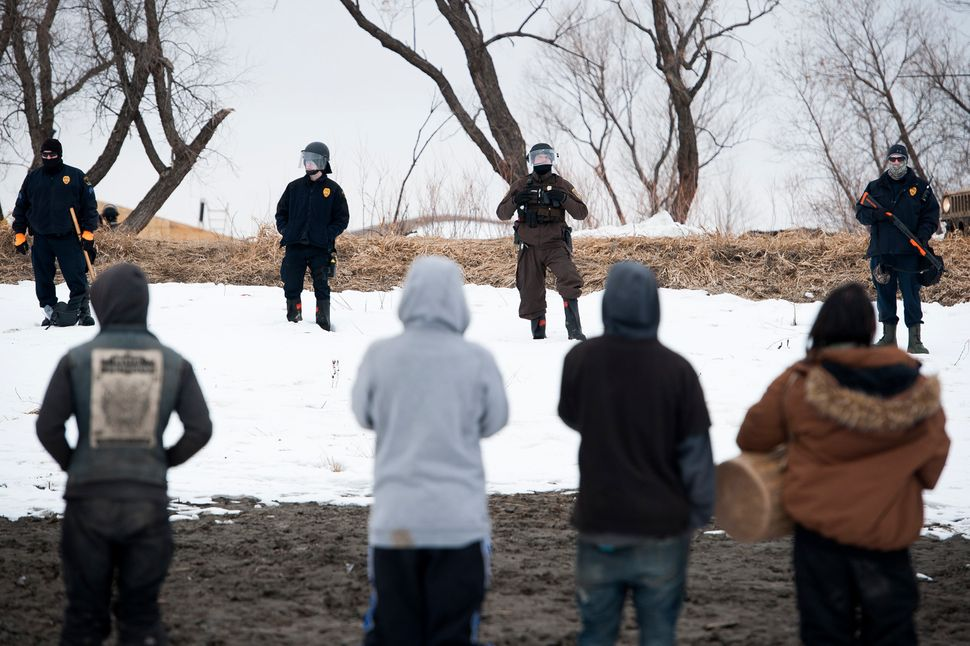 Water protectors face off against law enforcement.