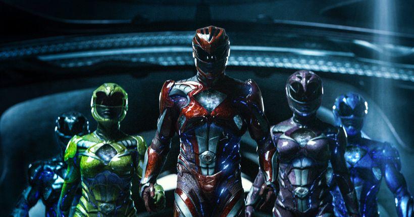 From left to right: Zack the Black Ranger (Ludi Lin), Trini the Yellow Ranger (Becky G), Jason the Red Ranger (Dacre Montgome