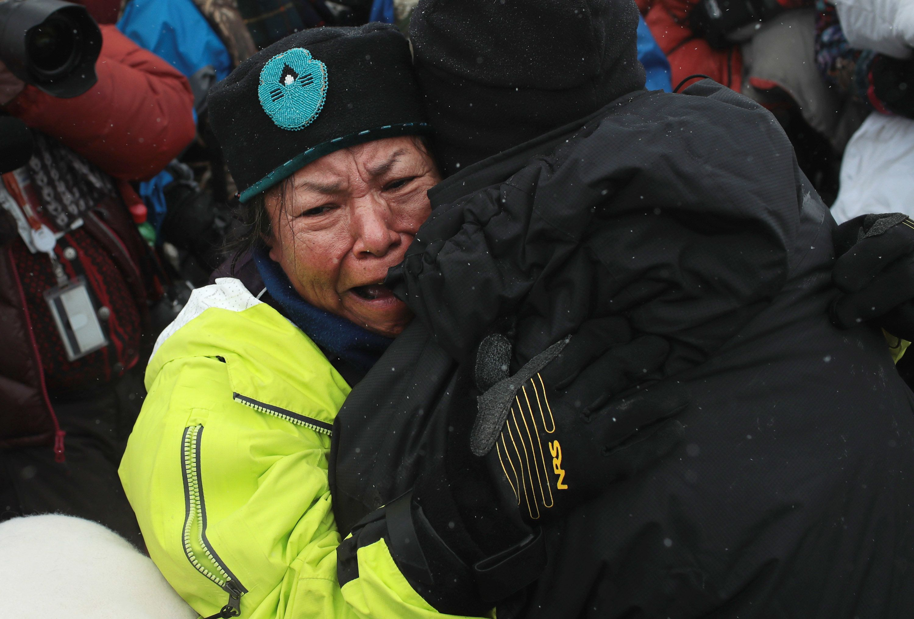 CANNON BALL, ND - DECEMBER 01:  Patty Sam Porter of the Colville tribe in Washington state is welcomed after traveling from the headwaters of the Missouri River in a dugout canoe to join activists at Oceti Sakowin Camp on the edge of the Standing Rock Sioux Reservation on December 1, 2016 outside Cannon Ball, North Dakota. Native Americans and activists from around the country have been gathering at the camp for several months trying to halt the construction of the Dakota Access Pipeline. The proposed 1,172-mile-long pipeline would transport oil from the North Dakota Bakken region through South Dakota, Iowa and into Illinois.  (Photo by Scott Olson/Getty Images)