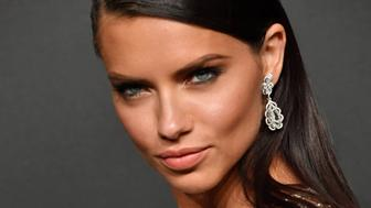 Brazilian model Adriana Lima poses as she arrives for the Chopard 'Space' party on the sidelines of the 70th Cannes film festival, on May 19, 2017 in Cannes, southeastern France.   / AFP PHOTO / Yann COATSALIOU        (Photo credit should read YANN COATSALIOU/AFP/Getty Images)