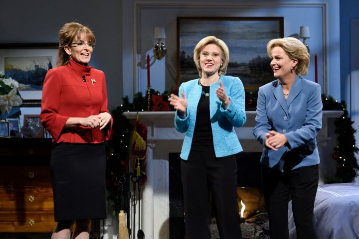 Tina Fey, as Sarah Palin, stands beside Kate McKinnon and Amy Poehler, both portraying Hillary Clinton, on Dec. 19, 2015