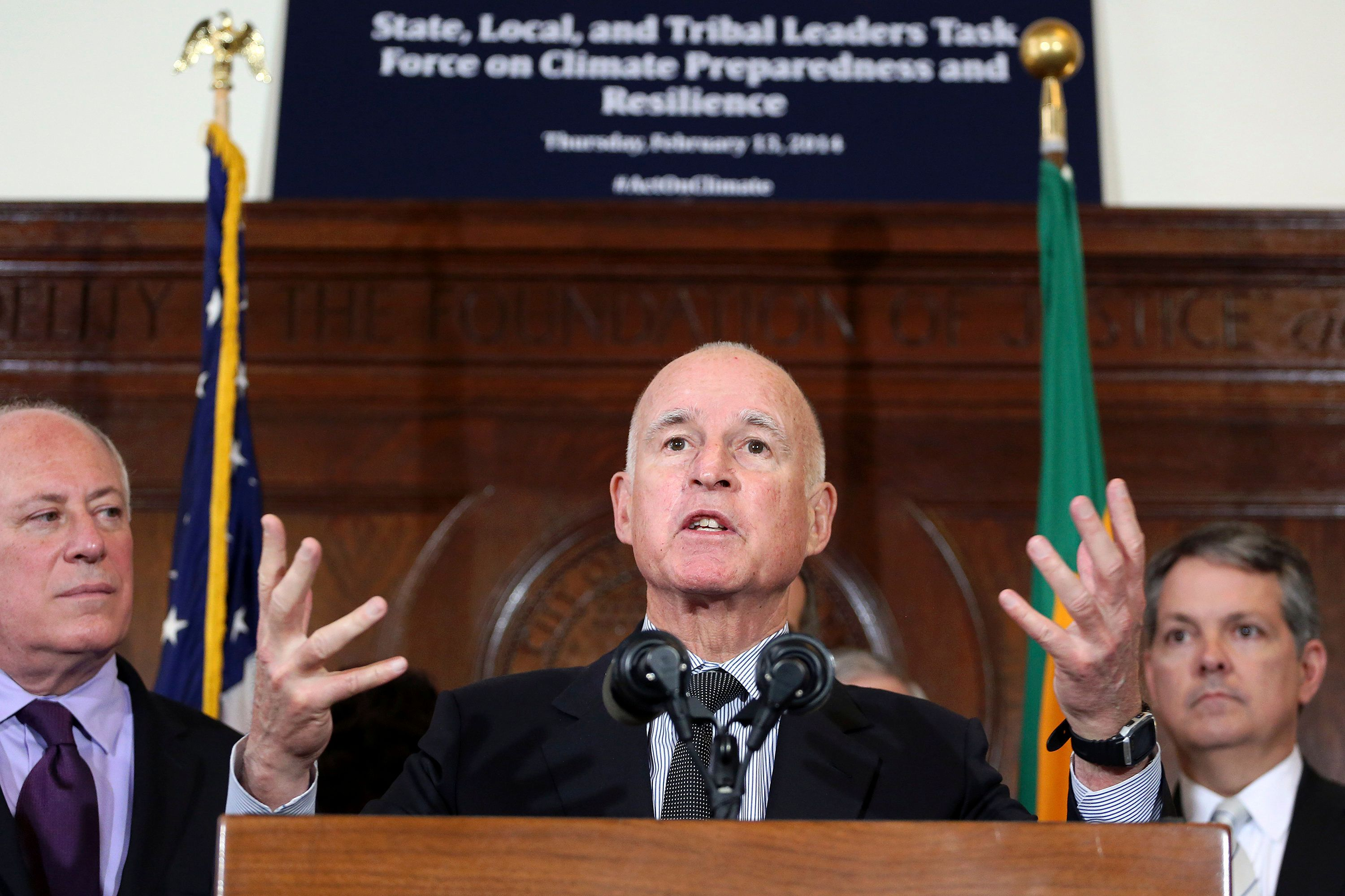 California Gov. Jerry Brown (C) speaks during a media briefing by members of President Barack Obama's Climate Task Force committee in Los Angeles, California February 13, 2014. REUTERS/Jonathan Alcorn (UNITED STATES - Tags: POLITICS ENVIRONMENT)