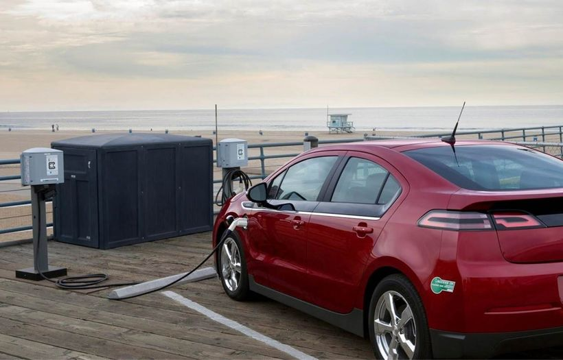 A beach-side electric vehicle charging station.