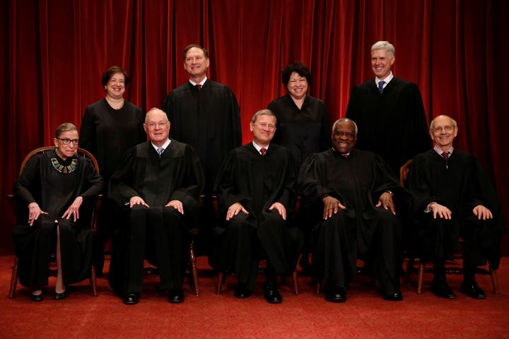 "Members of the Supreme Court take a new ""family"" photo on June 1, 2017. Front row, from left: Justice Ruth Bader Ginsburg, Ju"