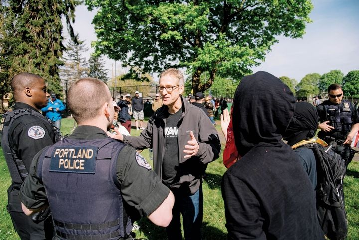 Portland Mayor Ted Wheeler,  who is also the Police Commissioner, speaking with police at Trump Free Speech Rally, April 29,