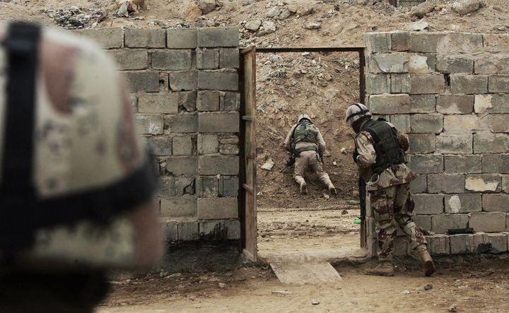 AU.S. soldier defuses a roadside bomb, February 2, 2006 in Khaldiyah, Iraq.