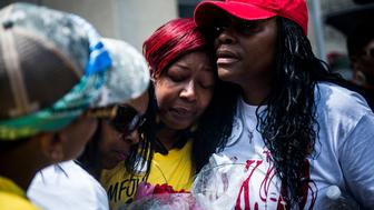 WASHINGTON, DC - MARCH 9:     Maria Hamilton, whose 31-year-old son Dontre was shot and killed by former Milwaukee Police Officer Christopher Manney in Red Arrow Park, WI, mourns during the Million Mom March, organized by Mothers for Justice, on May 9, 2015 in Washington, D.C.  The march, which brought mothers form across the country who lost their children to police brutality, was a call to action in the wake of recent murders by police officers around the country.   (Photo by Gabriella Demczuk/Getty Images)