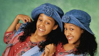 UNITED STATES - OCTOBER 06:  SISTER, SISTER - Gallery - Season One - 10/6/1993, Separated at birth, twin girls Tia and Tamera (Tia, left, and Tamera Mowry), unexpectedly encounter each other in a clothing store and conspire to run away together to Minneapolis-St. Paul, the ' twin cities'. The plan is discovered by their adoptive parents, who agree to share Ray's house despite their strong mutual dislike. ,  (Photo by ABC Photo Archives/ABC via Getty Images)