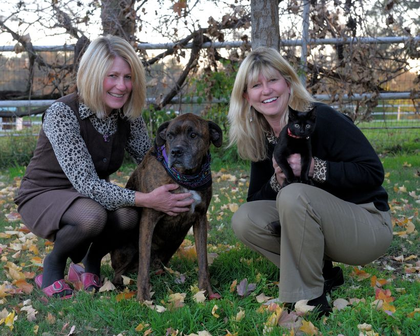 Jann and Joy together with their canine friend.