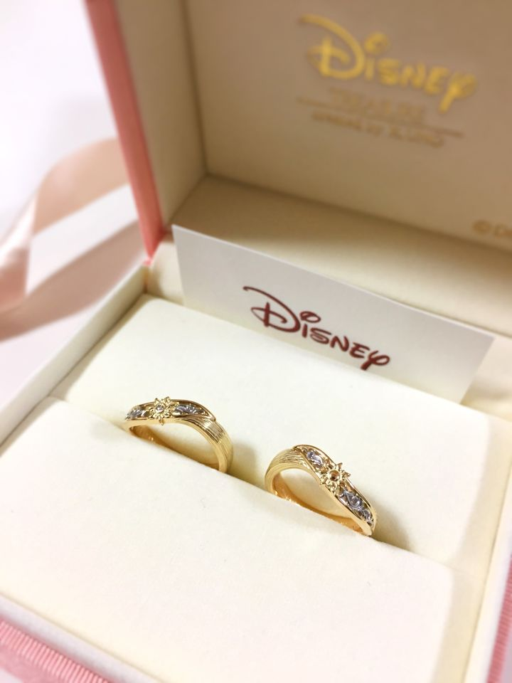 "The couple's rings were also inspired by the movie ""Tangled."""