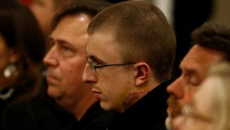 Micah Fletcher (C), the surviving victim of Friday's MAX train attack, watches as suspect Jeremy Christian (not shown) is arraigned in Multnomah County Circuit Court in Portland, Oregon, U.S., May 30, 2017.   REUTERS/Beth Nakamura/Pool