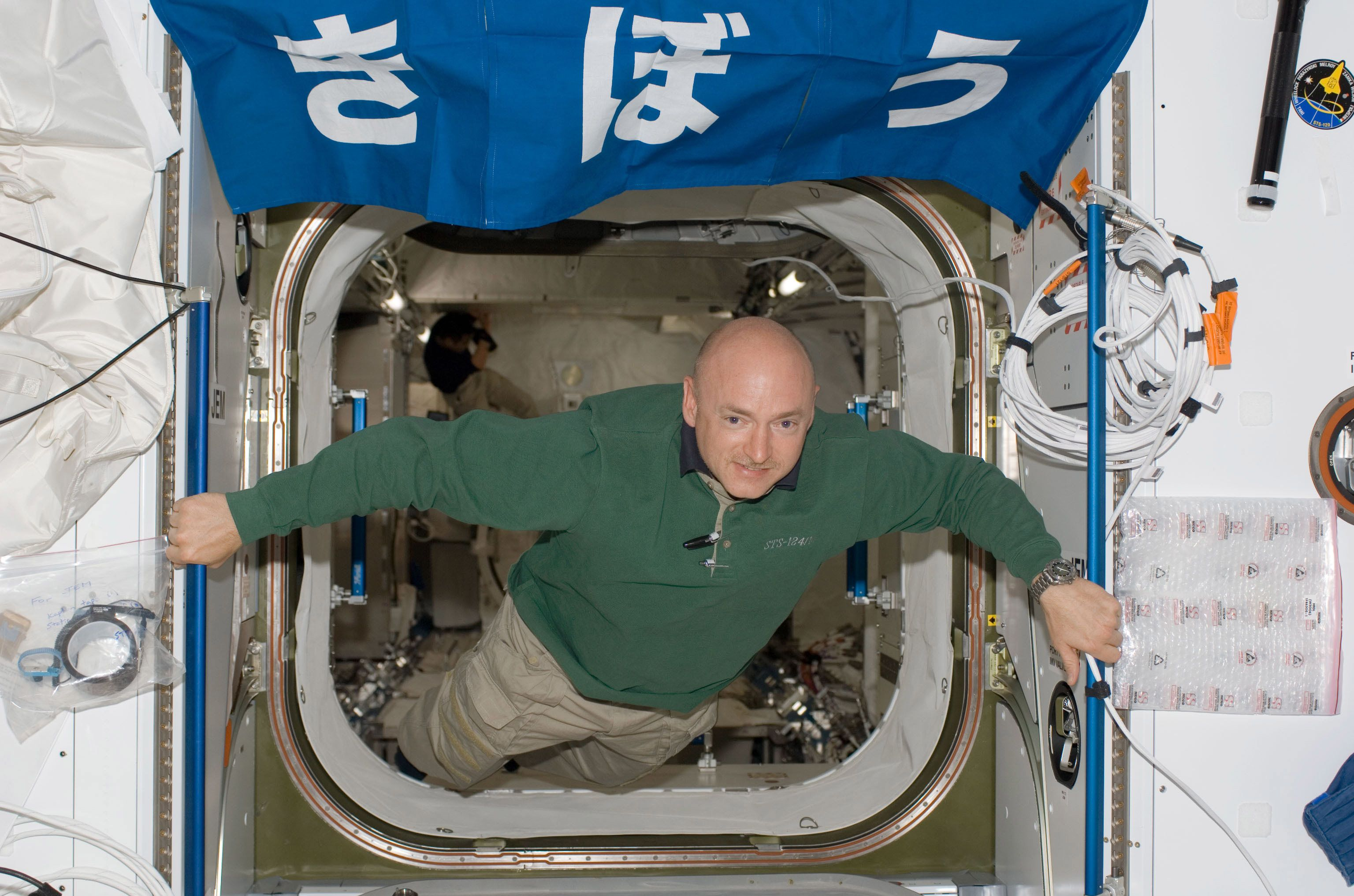 IN SPACE - JUNE 4: (FILE PHOTO) In this handout image provided by NASA, astronaut Mark E. Kelly, STS-124 commander, floats in the hatch between the Harmony node and the newly installed Kibo Japanese Pressurized Module (JPM) of the International Space Station while Space Shuttle Discovery is docked with the station June 4, 2008 in space. Mark E. Kelly's wife, U.S. Rep. Gabrielle Giffords (D-AZ) was shot in the head at a public event entitled 'Congress on your Corner' when a gunman opened fire outside a Safeway grocery store January 8, 2011 in Tucson, Arizona. It was reported that eighteen people were shot, including members of Giffords' staff, and six were killed, including one young child. (Photo by NASA via Getty Images)