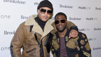 NEW YORK, NY - DECEMBER 03:  T.I. and Kevin Hart, partner of Muzik One Headphones, kick off the holiday season with shoppers at Brookstone in Times Square on December 3, 2016 in New York City.  (Photo by Matthew Eisman/Getty Images for Muzik)