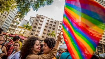 Activists participate in the Walk of Lesbian and Bisexual Women in Largo Payssandu, central SP. The act was organized by the LGBT (lesbian, gay, bisexual and transgender) in São Paulo, Brazil, on May 28, 2016. Posters displayed while walking criticized the current President of Brazil, Michel Temer.  (Photo by Cris Faga/NurPhoto via Getty Images)