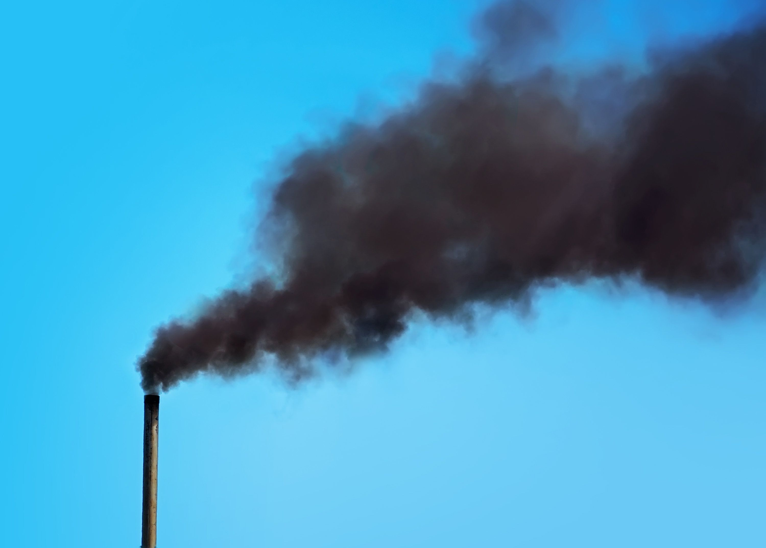 Black pipe with black smoke. Factory chimney smoking, heavy black smoke on the sky. ecology problems