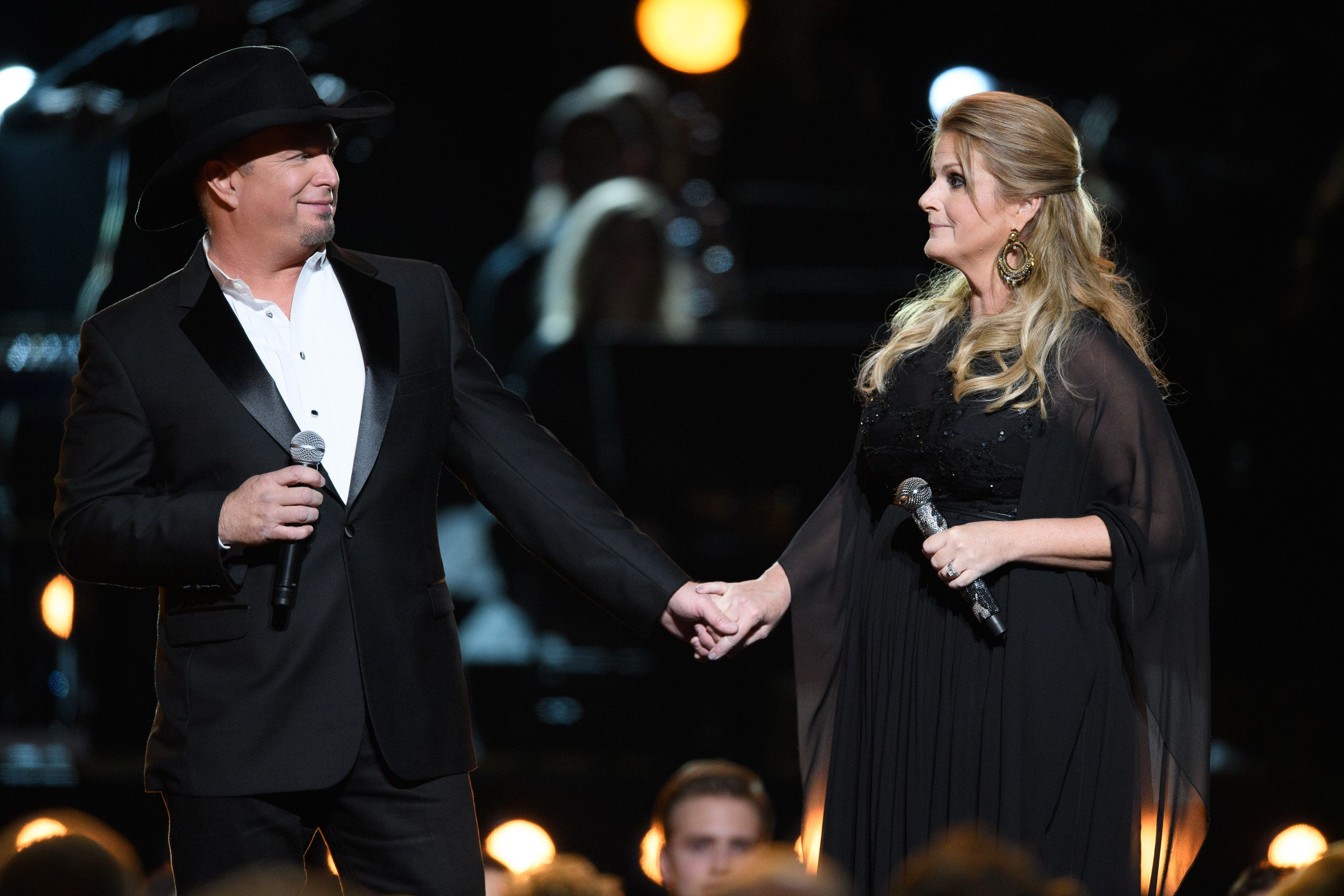 THE 50th ANNUAL CMA AWARDS - The 50th Annual CMA Awards, hosted by Brad Paisley and Carrie Underwood, broadcasts live from the Bridgestone Arena in Nashville, Wednesday, November 2 (8:00-11:00 p.m. EDT), on the ABC Television Network. (Image Group LA/ABC via Getty Images) GARTH BROOKS, TRISHA YEARWOOD