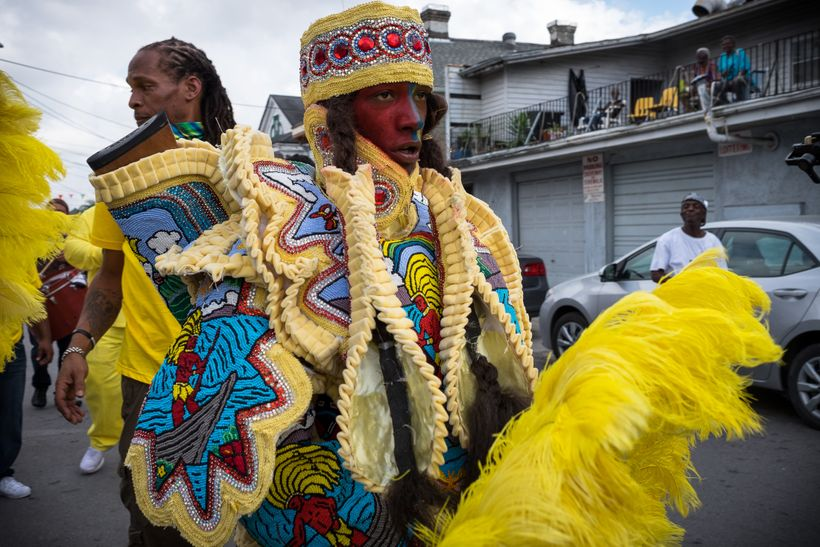 A spyboy from a Black Masking Indian tribe patrols the street in front of Joyce Montana's house on Carnival Day, February 28,