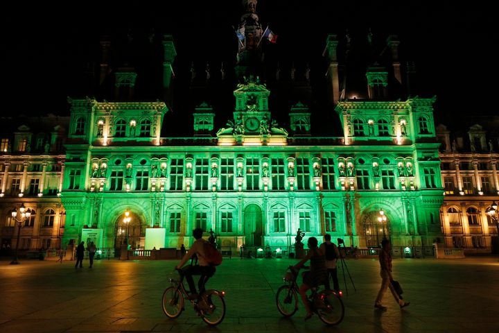 Green lights are projected onto the facade of the Hotel de Ville in Paris, France, after Trump announced his decision that th