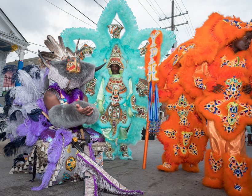 Shaka Zulu stands with his tribe's Wildman, flagboy, and spyboy on the street in front of Joyce Montana's house on Carnival D