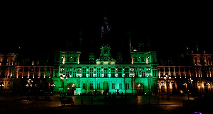 A picture taken Thursday shows the city hall of Paris illuminated in green following Trump's announcement that the
