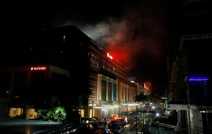 Smoke billows from the Resorts World building in Manila on Friday.