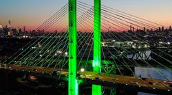 City Halls, Bridges Across America Glow Green To Show Continued Support For Paris