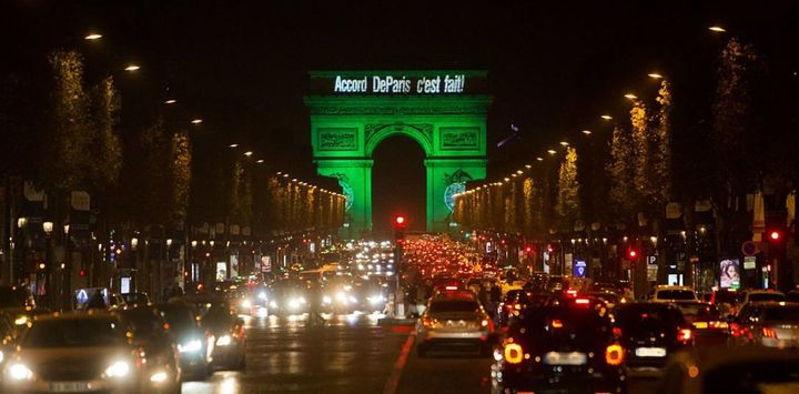 The Arc de Triomphe Is illuminated in green to celebrate the Paris Agreement's entry into force.