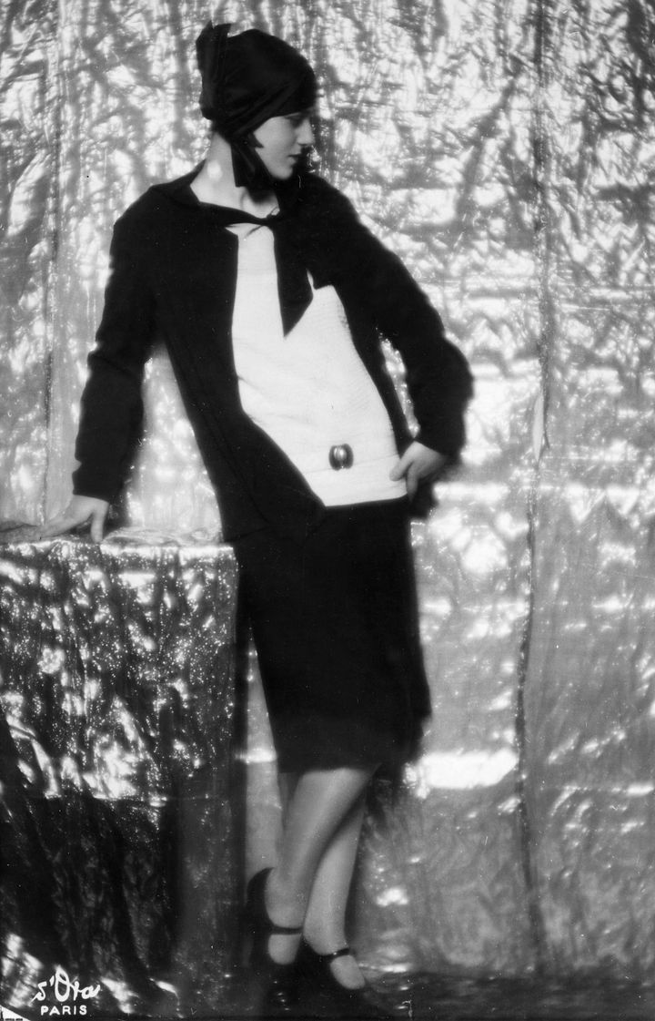 Woman wearing a black marocain dress with a white Romain crepe blouse - undated, though thought to be around1928.