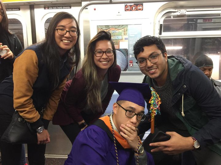 Alcantara and his friends and girlfriend celebrating his graduation on the subway.