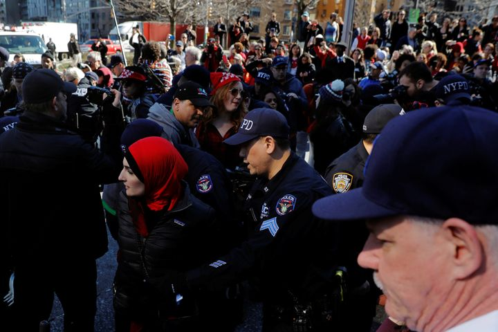 New York Police Department officers arrest an organizer Linda Sarsour who was taking part in a 'Day Without a Woman' march on