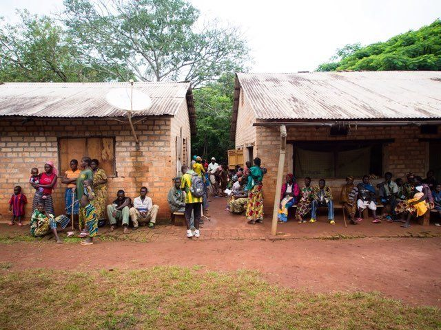People wait in front of Uganda People's Defence Force (UPDF) hospital on June 25, 2014, in Obo. Now women are worried w