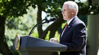 U.S. Vice President Mike Pence speaks during an announcement in the Rose Garden of the White House in Washington, D.C., U.S., on Thursday, June 1, 2017. President Donald Trump announced the U.S. would withdraw from the Paris climate pact and that he will seek to renegotiate the international agreement in a way that treats American workers better. Photographer: T.J. Kirkpatrick/Bloomberg via Getty Images