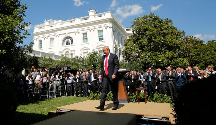 President Donald Trump leaves the Rose Garden of the White House on Thursday after announcing his decision that the