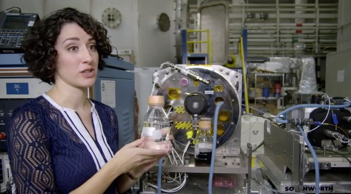 NASA engineer Jennifer Pruett shows off a distillery that can turn urine into drinking water.