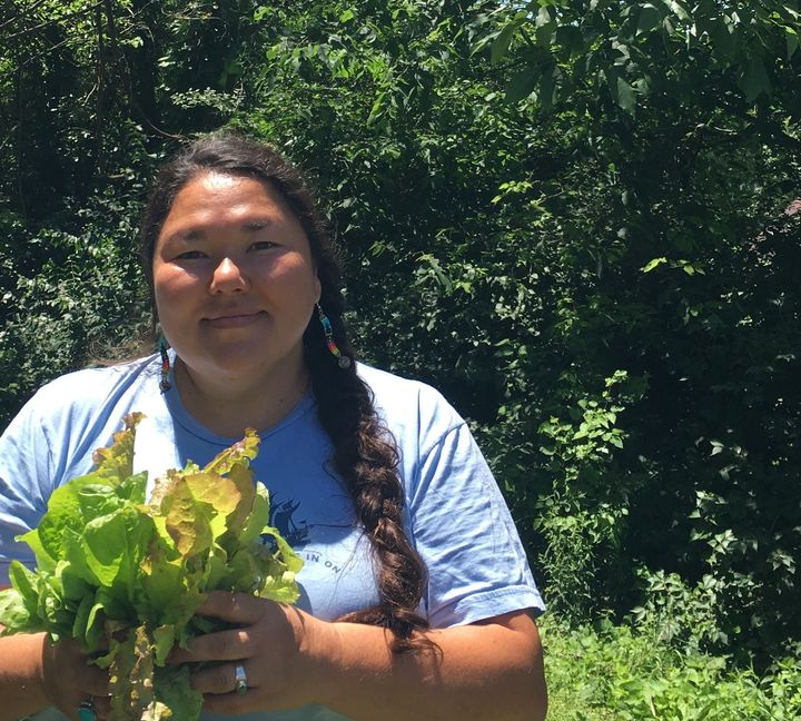 Linda Black Elk holds red-leaf and romaine lettuce grown in South Dakota that was donated to Dakota Access Pipeline protester