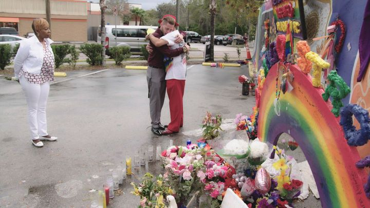 Pulse shooting survivors Chris Littlestar and Orlando Torres embrace at the scene of their shared trauma as life coach Iyanla