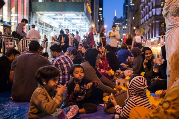 Adults and families were present in the crowd, sharing an iftar meal on the sixth night of Ramadan.