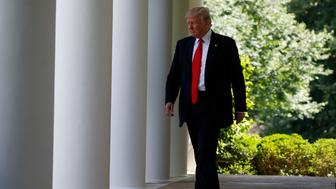 U.S. President Donald Trump arrives to announce his decision that the United States will withdraw from the landmark Paris Climate Agreement, in the Rose Garden of the White House in Washington, U.S., June 1, 2017. REUTERS/Joshua Roberts