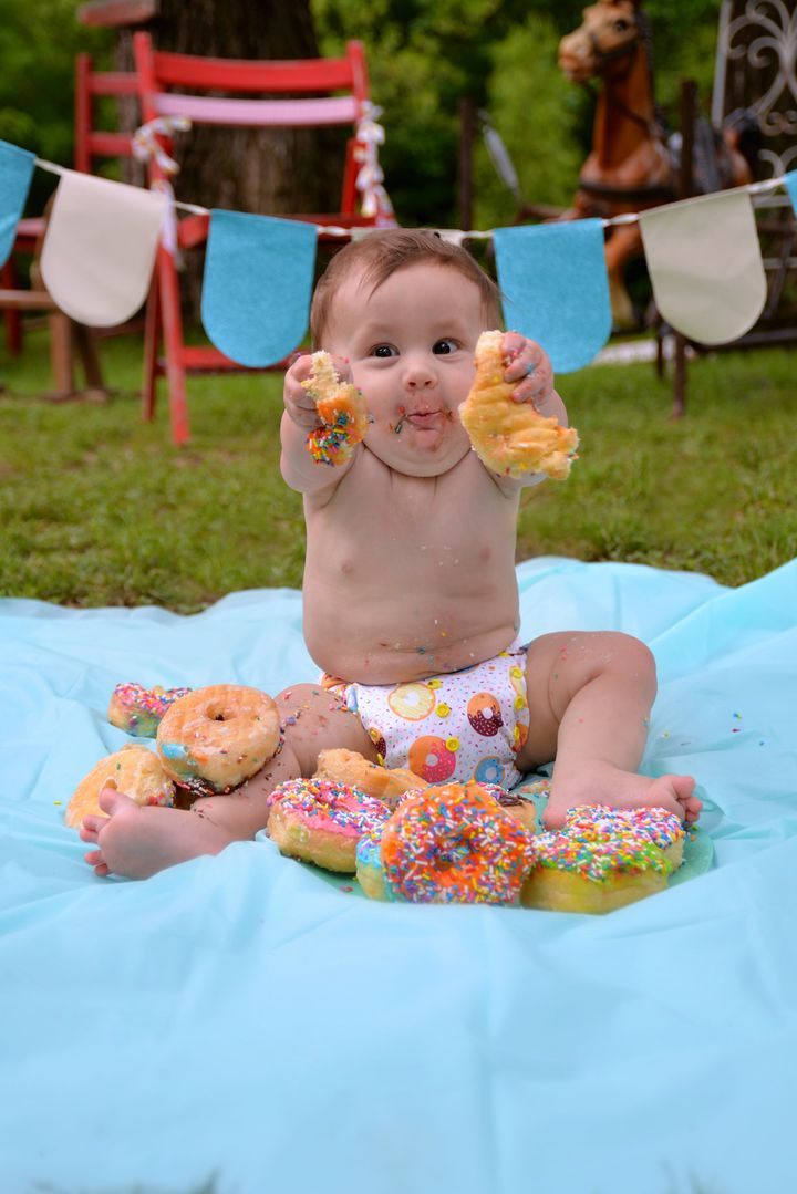 It Doesn't Get Much Cuter Than This Baby's Donut Smash Photos 5931cc66230000570e34889f
