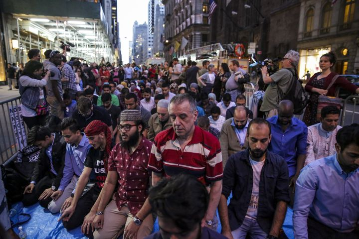 Demonstrators pray during an iftar outside of Trump Tower in New York City on Thursday, June 1, 2017.