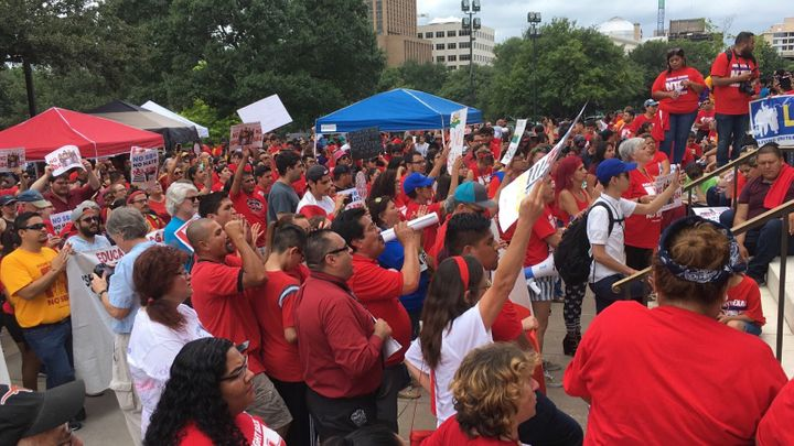 Immigrants with the Fair Immigration Reform Movement protest Gov. Greg Abbott's Show Me Your Papers law in Texas's state capi