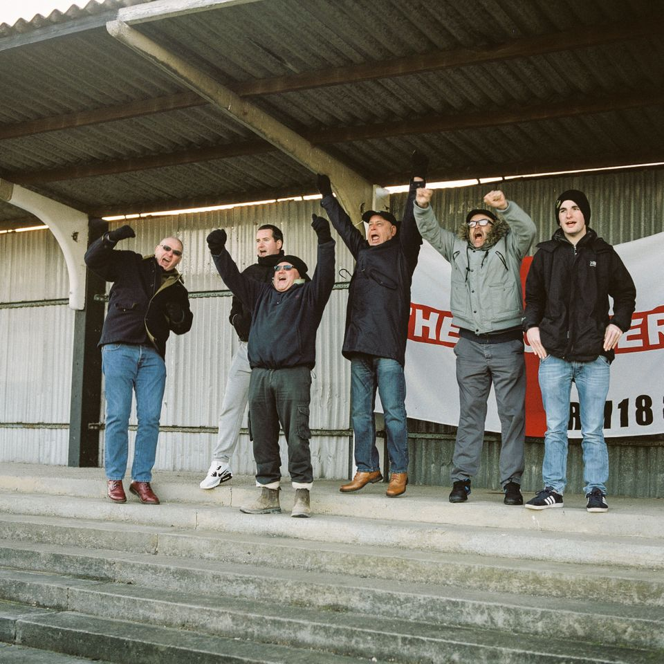 Mick (L), John (3R) and friends celebrate Tilbury scoring against Haringey on Jan