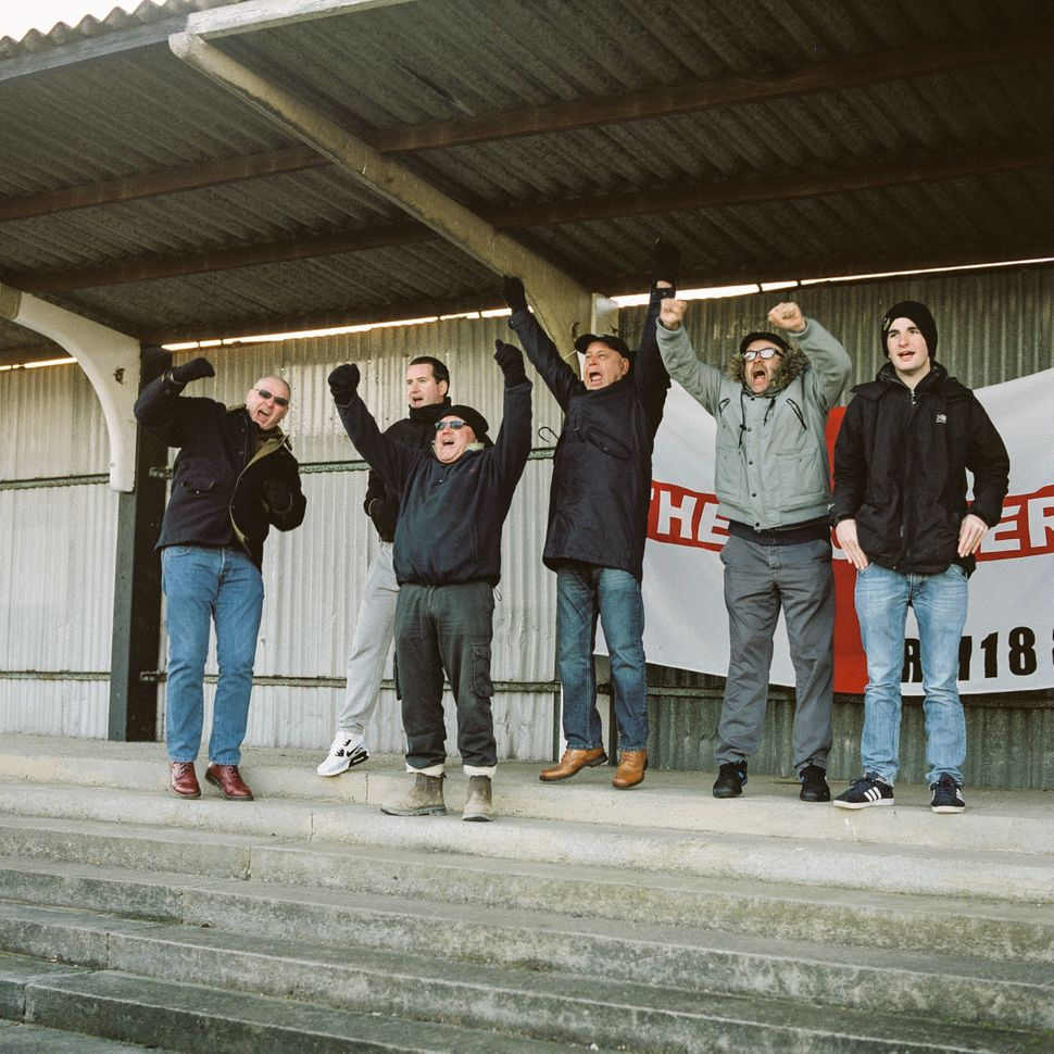 Mick (L), John (3R) and friends celebrate Tilbury scoring against Haringey on Jan 14.