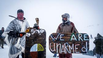 OCETI SAKOWIN CAMP, CANNONBALL, NORTHDAKOTA, UNITED STATES - 2016/12/05: Winter has arrived in Standing Rock at the Oceti Sakowin Camp in North Dakota, the day after the Army Corps of Engineers denied the easement needed to build the pipeline. Despite driving snow and 40-plus mile an hour wind a group of 700-plus veterans and water protectors marched toward the barricade on highway 1806. (Photo by Michael Nigro/Pacific Press/LightRocket via Getty Images)