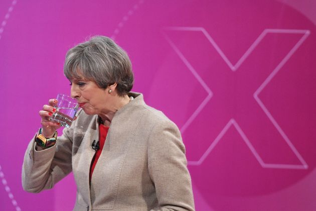 Prime Minister Theresa May sips some water as she takes part in the BBC's Question Time on