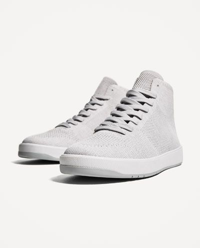 "<i>Grey fabric high top sneakers, <a href=""https://www.zara.com/us/en/man/shoes/sneakers/grey-fabric-high-top-sneakers-c35806"
