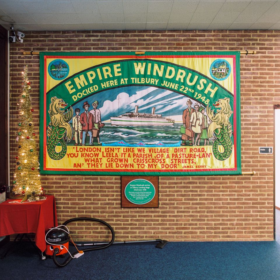 A banner commemorating the Empire Windrush on the wall of Tilbury Cruise Terminal on Dec. 19,