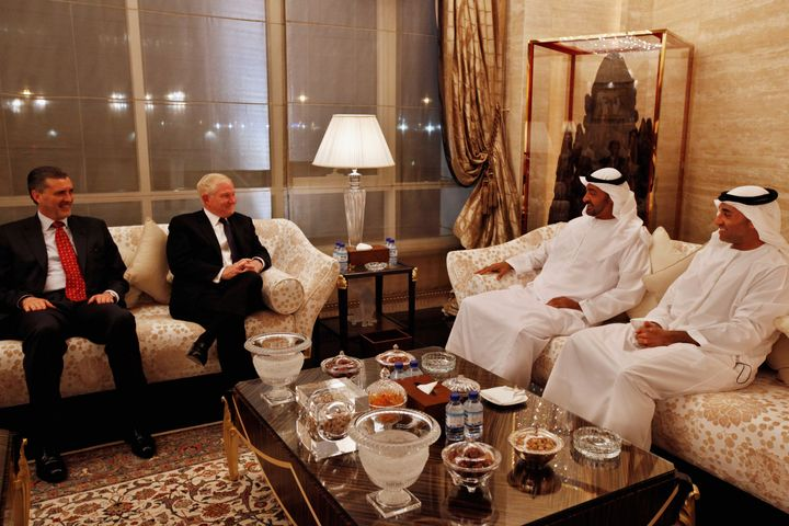 Former Defense Secretary Bob Gates, second left, was in frequent contact with Otaiba, far right. He spoke on May 23 at a Foun